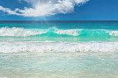 Beautiful sea wave on tropical beach.