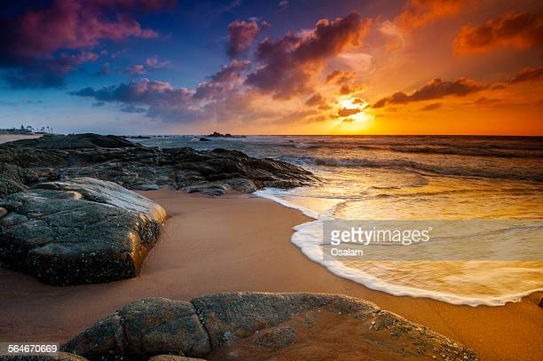 Sunrise or sunset of rock water beach, Long Hai, V