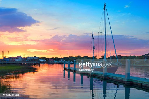 Sunrise Over A Docked Sailboat In Charleston South Carolina : Stock Photo