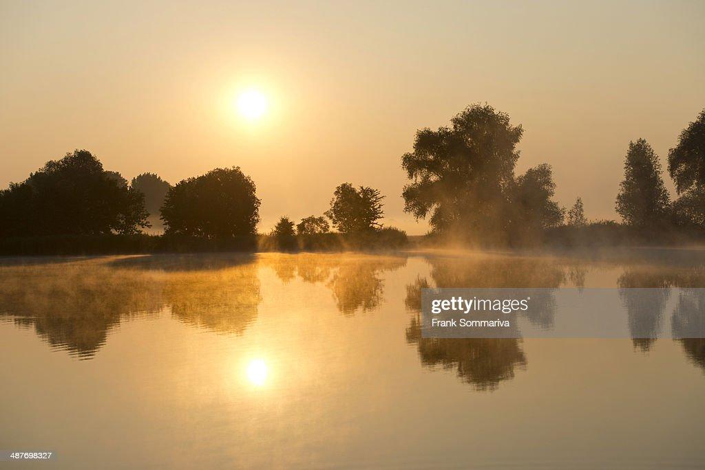 Sunrise over a pond landscape, Herbsleben, Thuringia, Germany