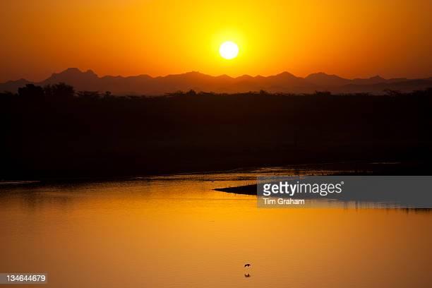 Sunrise over Aravalli Mountain Range at Chattra Sagar reservoir and bird reserve at Nimaj Rajasthan Northern India