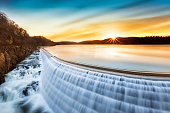 Sunrise over Croton Dam, NY and its stepped spillway waterfall. A very long exposure and the natural motion blur creates an artistic smooth and silky effect on the falling water.