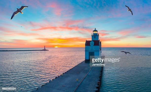 Sunrise over Lake Michigan scenic harbor and lighthouse