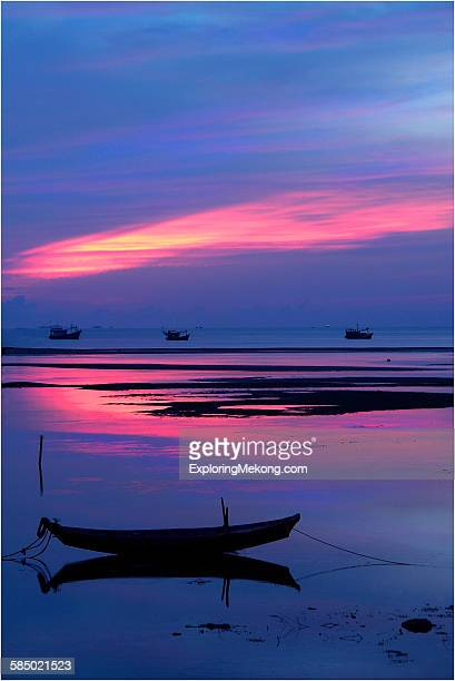sunrise over lonely boats