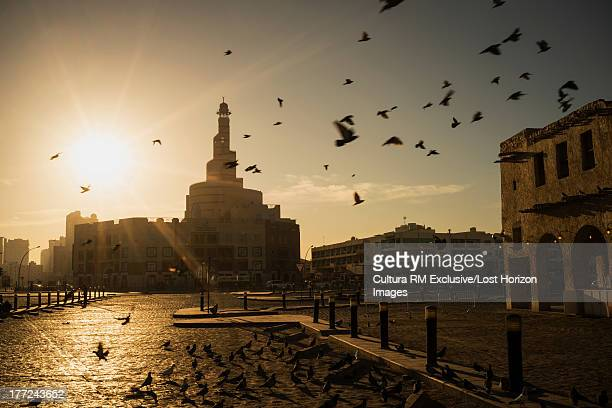 Sunrise over minaret of Qatar Mosque/ Islamic Cultural Center (Fanar), Doha, Qatar