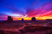 Dramatic and very colorful sunrise over Monument Valley in Arizona, USA. Long exposure.