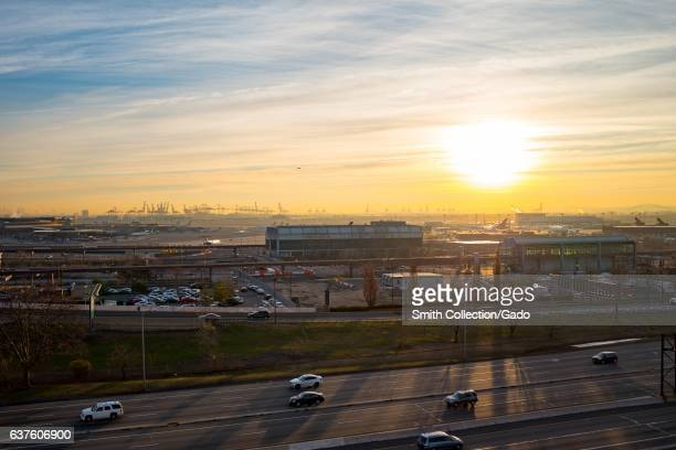 Sunrise over Newark Liberty International Airport with traffic on US Route 9 visible Newark New Jersey December 21 2016