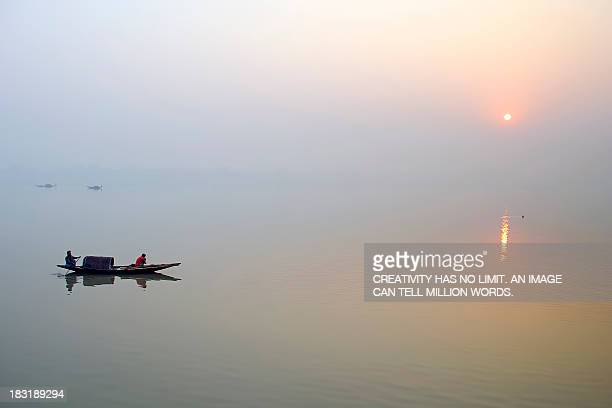Sunrise Over River Ganges on a Misty Morning