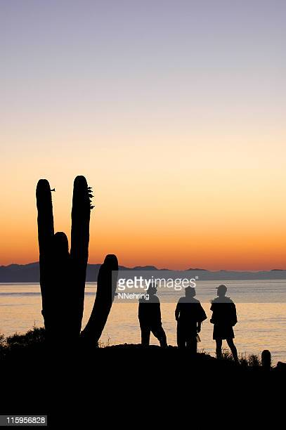 sunrise over Sea of Cortez silhouetting of cactus and people