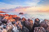 Sunrise over the Coast of Sicily. Dawn at Capo Gallo Coast near Palermo at Mondello on a warm autumn morning. Lovely sun and waves in the sea