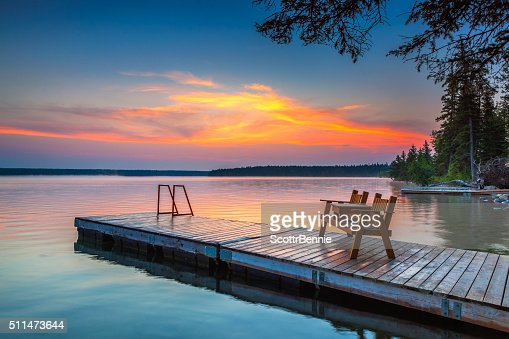 Sunrise over the dock in Clear Lake, Manitoba : Stock Photo