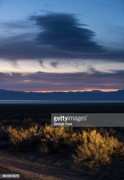 Sunrise over the formerly dry lake bed of Owens Lake is viewed on April 7 near Olancha California Owens Valley is an arid valley in eastern...