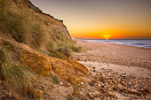 In early December, the sun rises over the Isle of Wight, east of Warren Hill, the large landmass which comprises most of Hengistbury Head. The shingle beach stretches from here to Sandbanks in the wes