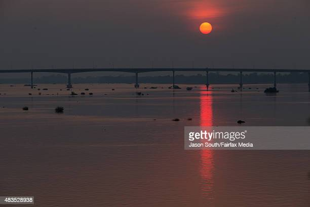 Sunrise over the Mekong River on May 7 2015 in Stung Treng Cambodia Conservationists and politicians are warning the quest for hydropower is...