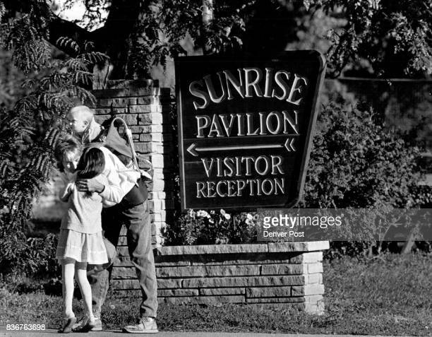 Sunrise Ranch 5 year old Jenny Miller kisses her mom Mary goodbye while waiting for school bus to go to kindergarten in Loveland Her brother Aubrey 1...