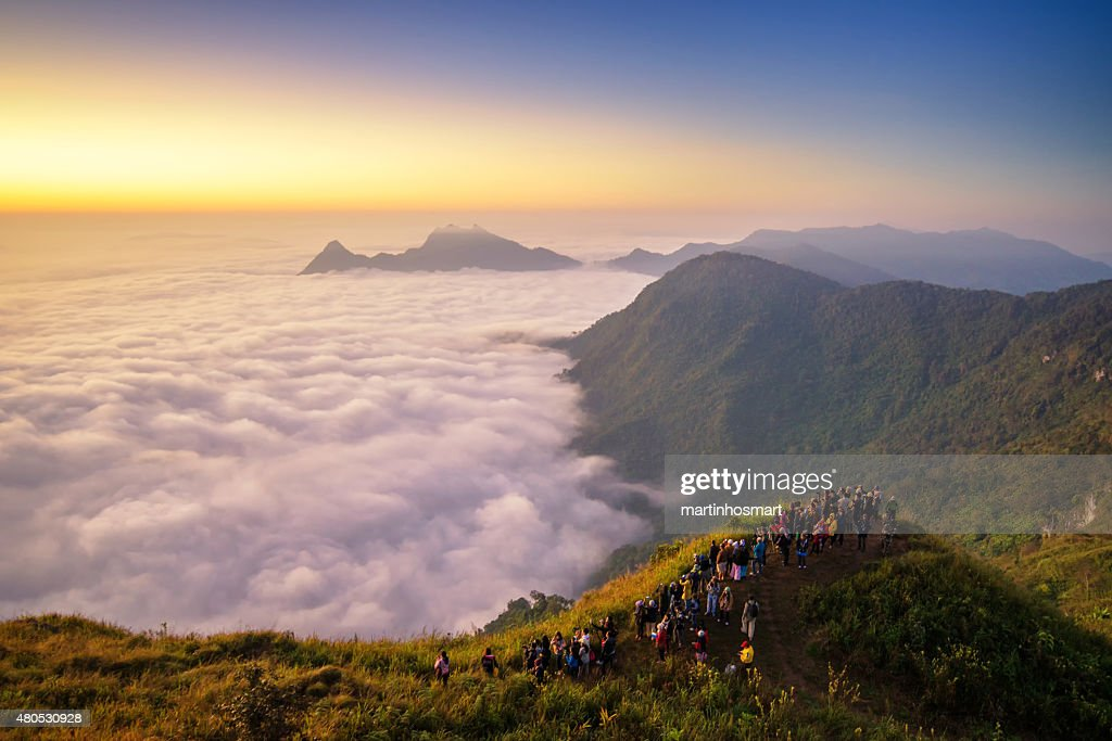 Sunrise scene with the peak of mountain and cloudscape : Stock Photo