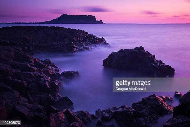 Sunrise, sea and coastal landscape