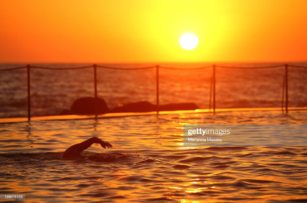 Sunrise swimmers take to Bronte Pool in Bronte Beach to beat the heat as temperatures are expected to reach record highs today on January 8, 2013 in Sydney, Australia.
