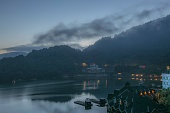 Sunrise with Boats, Mountains, Lake and Pier in Sun Moon Lake, Taiwan