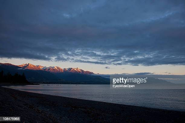 Sunrise with the summit of Mount Fyffe in Kaikoura Bay on December 07 2010 in Kaikoura South Island New Zealand