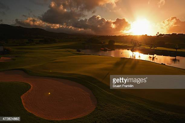 Sunrises over the 18th green before the start of the final round of the AfrAsia Bank Mauritius Open at Heritage Golf Club on May 10 2015 in Bel Ombre...