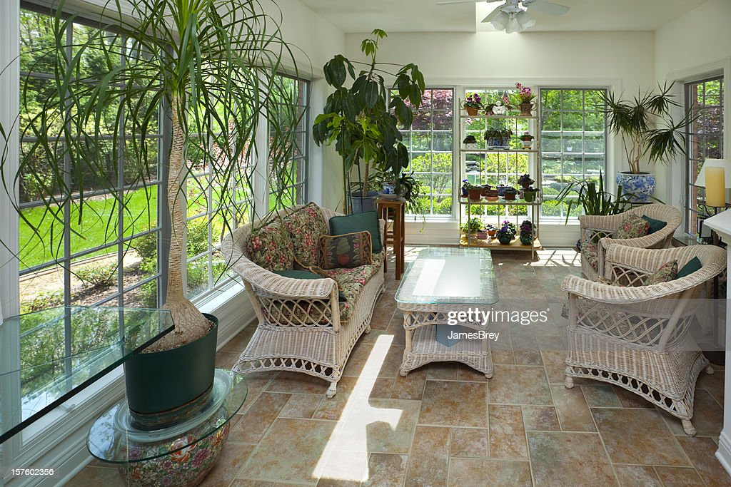 Sunroom greenhouse interior with casual wicker furniture for Casual chairs for sunroom