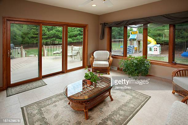 Sunroom With View of Back Yard, Patio Deck, Children's Playground