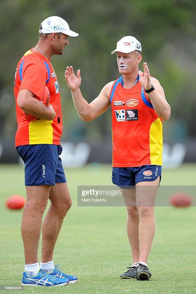 Suns coach Guy McKenna Speaks with Matthew Primus (L) during a Gold Coast Suns pre-season AFL training session at Metricon Stadium on November 26, 2012 on the Gold Coast, Australia.