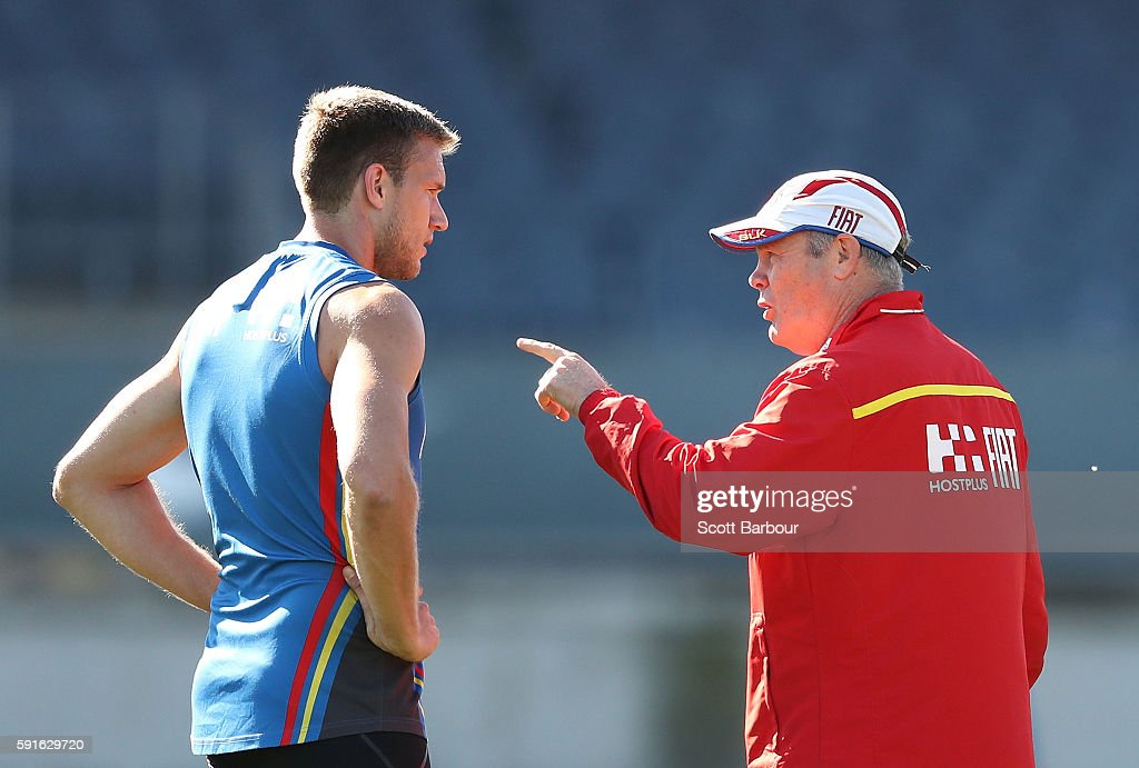 Suns head coach Rodney Eade speaks with Sam Day of the Suns during a Gold Coast Suns AFL training session at Ikon Park on August 18 2016 in Melbourne...
