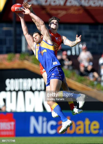Suns player Alex Sexton and West Coast Eagles player Jack Darling challenge for the ball during the round 11 AFL match between the Gold Coast Suns...