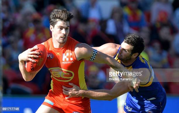 Suns player Alex Sexton attempts to break away from the defence of West Coast Eagles player Jack Darling challenge for the ball during the round 11...