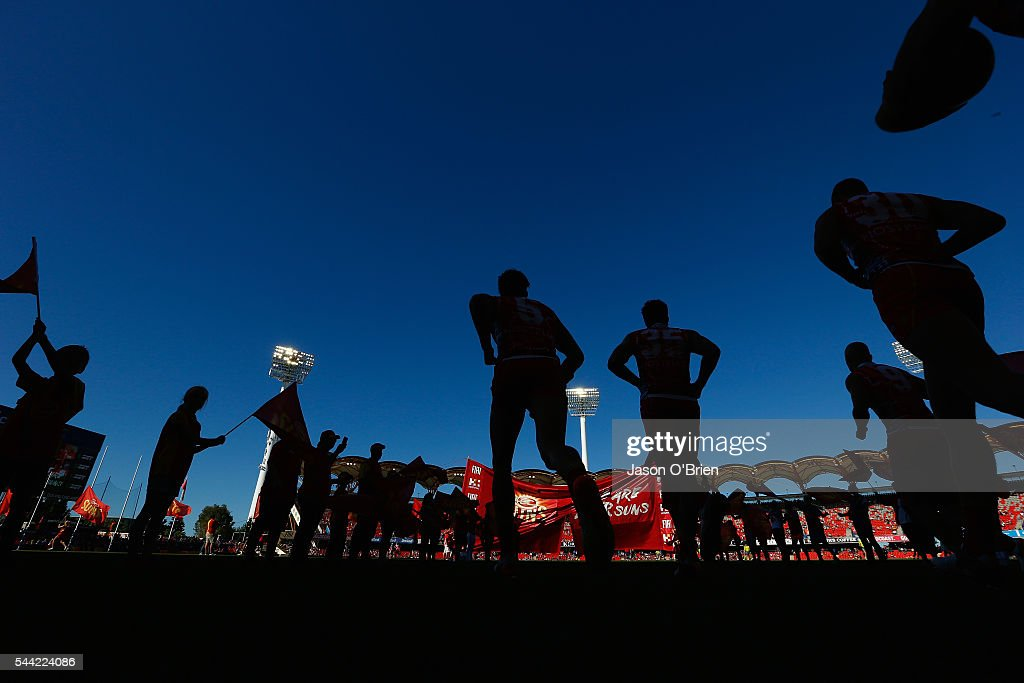 Suns players take the field during the round 15 AFL match between the Gold Coast Suns and the St Kilda Saints at Metricon Stadium on July 2, 2016 in Gold Coast, Australia.