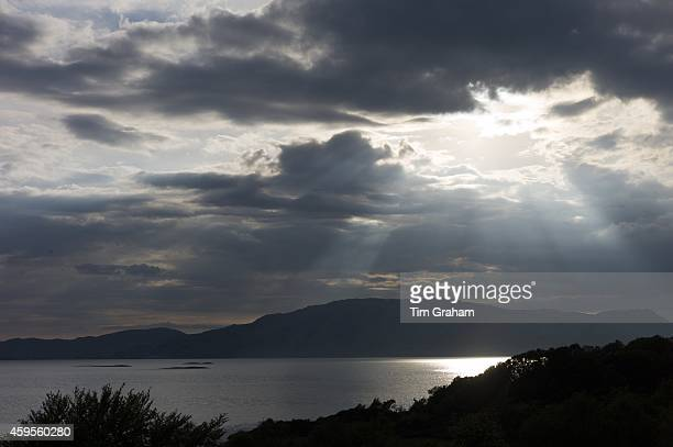 Sun's rays break through grey clouds onto Loch Linnhe in late afternoon early evening near Strontian Argyll in the Highlands of Scotland