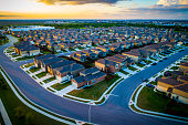 Suburb aerial drone view high above homes in Austin Texas thousands of homes into the distance