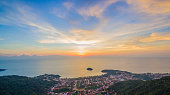 aerial photography the waygo to Kata Noi beach Kata beach and Karon beach in sunset on the way can see big Buddha on right side big Buddha is on the top of Nagkerd mountain.