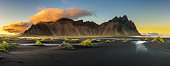 Sunset above  Vestrahorn (Batman Mountain) and its black sand beach in Iceland