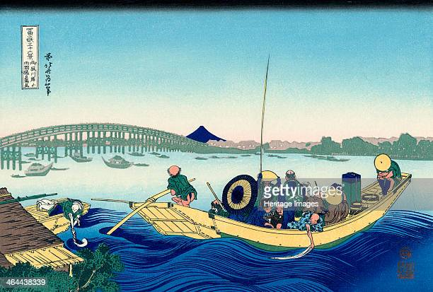 Sunset across the Ryogoku bridge from the bank of the Sumida River at Onmayagashi 18301833 From a Series 36 Views of Mount Fuji Hokusai Katsushika...