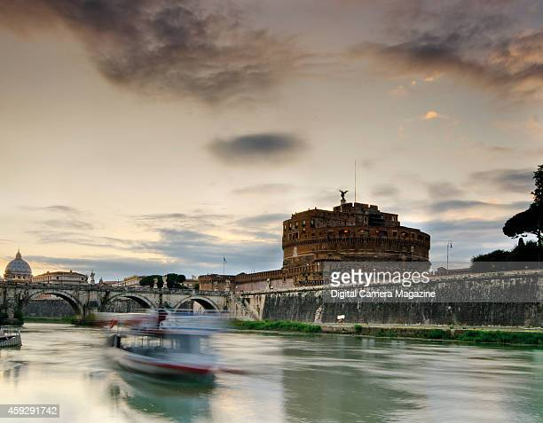 Sunset across the Tiber River by Castel Sant'Angelo in Rome taken on May 13 2012 The Castel is well known as the mausoleum of the Roman emperor...