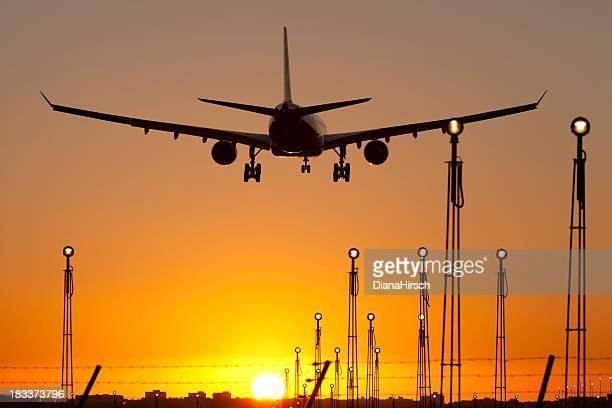 sunset airplain landing in majorca