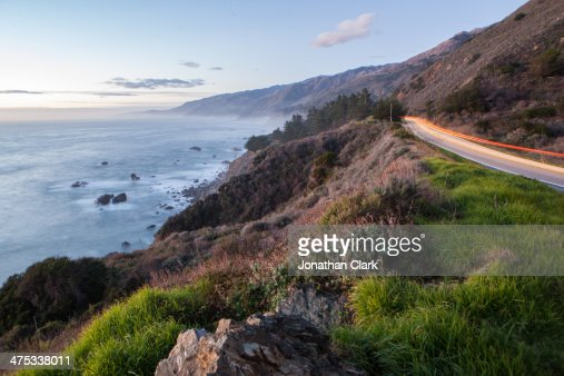 Sunset and car streaks along The Big Sur coastline