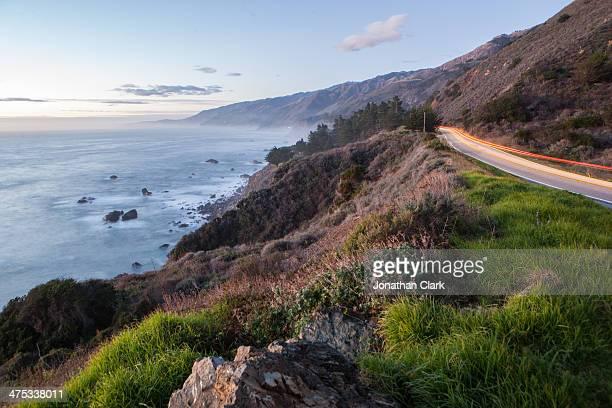Sunset and car streaks along The Big Sur coastline