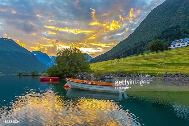 Sunset and floating Boats on magnificent fjords of Norway