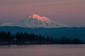 A beautiful alpenglow touches Mt. Baker during a glorious winter sunset.