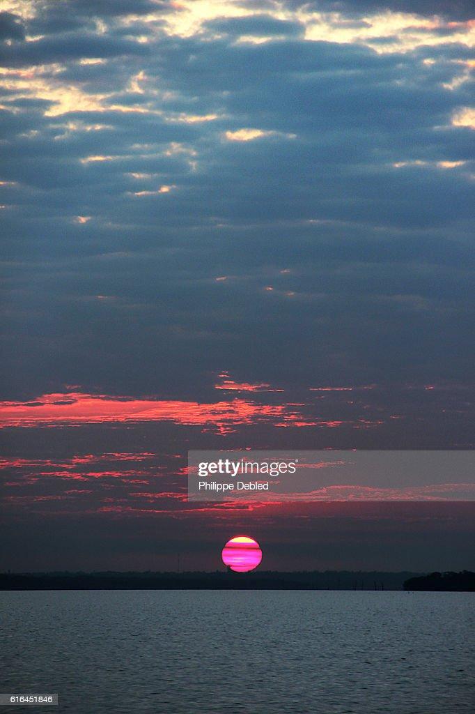 Sunset and red sky over Itaipu Lake, Foz do Iguaçu, Paraná State, Brazil : Stock Photo