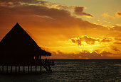 Sunset and tropical bungalow