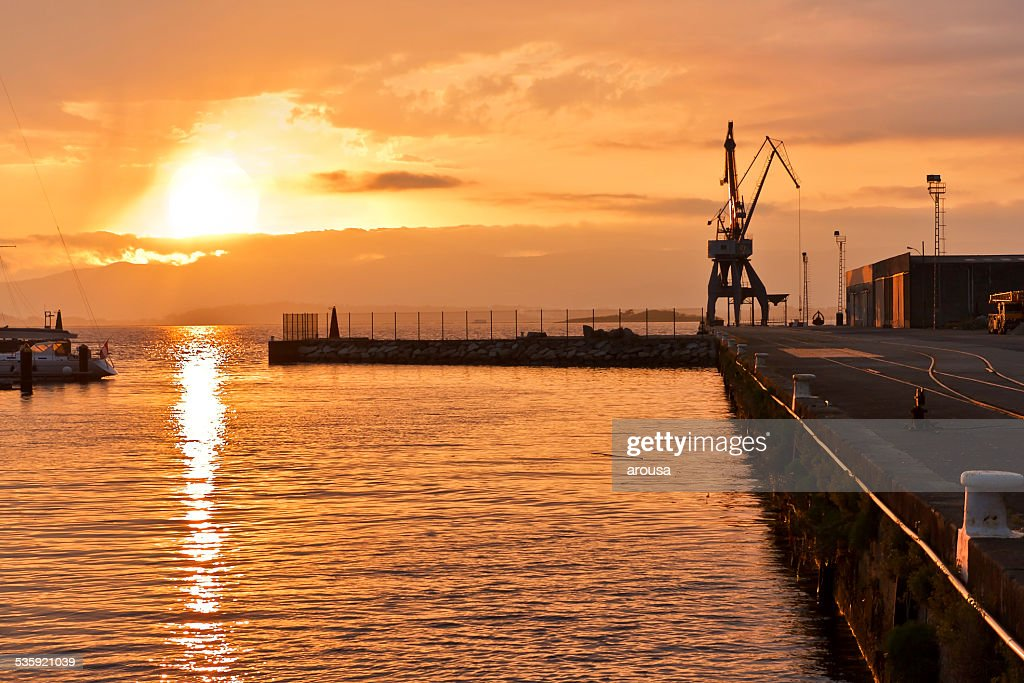 Sunset at commercial port : Stock Photo