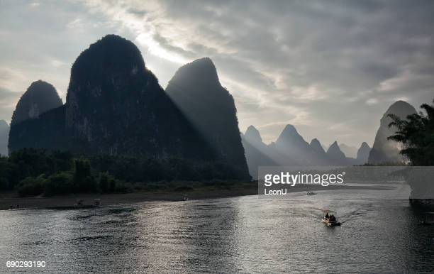 Sunset at foggy Li River, Guilin, China