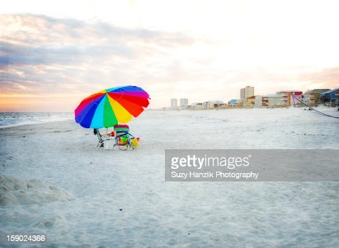 sunset at Gulf Shores, Al beach with umbrella : Stock Photo
