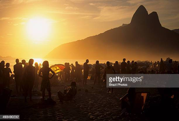 Sunset at Ipanema beach bathed in hazy afternoon light Rio de Janeiro Brazil