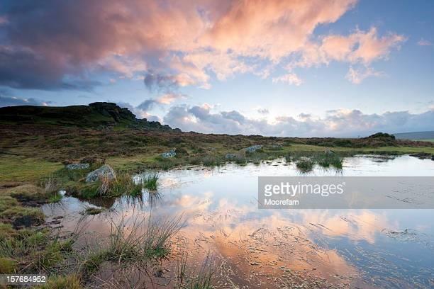 Sunset at Saddle Tor by a pond on Dartmoor